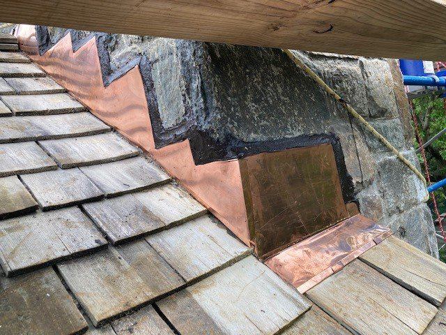 new chimney flashing installed and sealed after completing chimney flashing repairs