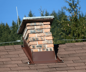close up of chimney with chimney flashing around it on roof