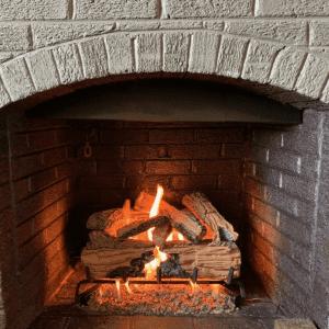 Gas logs in fireplace burning.